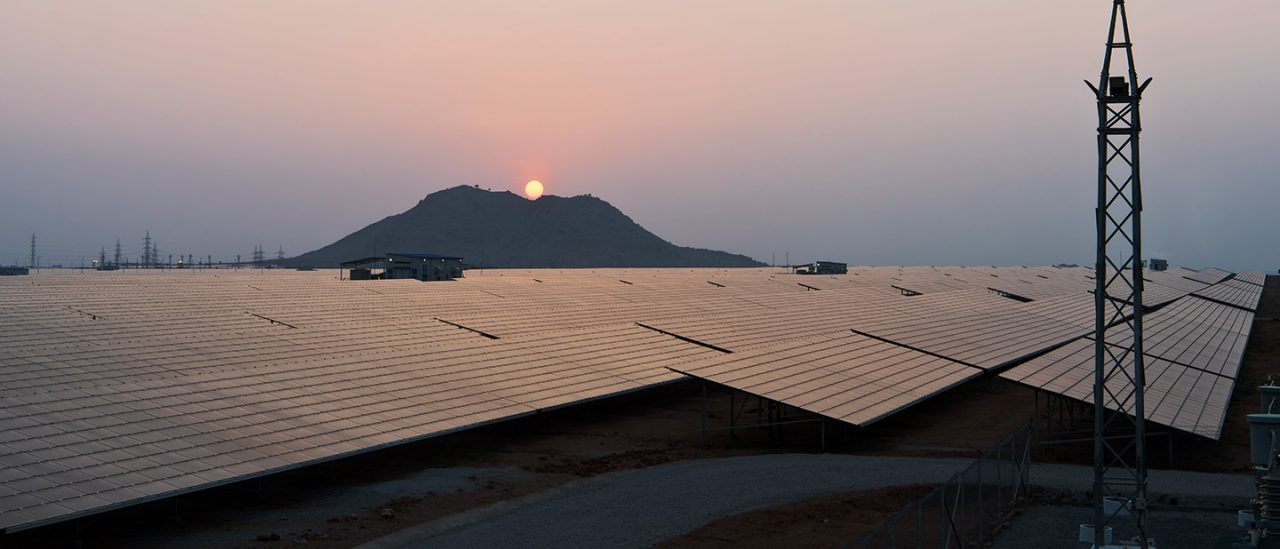 Sunset over solar panel farm